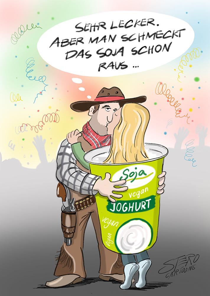 Mann im Cowboykostüm küsst Frau im Sojajoghurt-Kostüm auf einer Fasnachtsparty