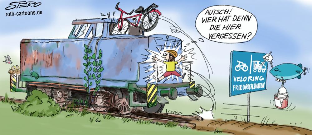 Cartoon/Karikatur Güterlok und Fahrradfahrer